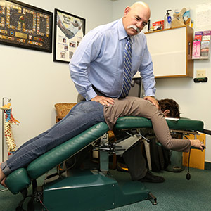 Chiropractor using Diversified, COX and Leander Techniques